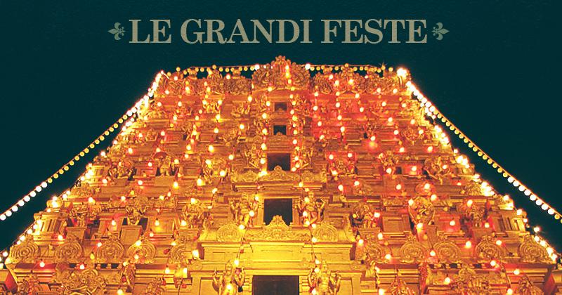 un tetto di tempio del sud illuminato da tante lampadine e la scritta in alto: le feste dell'India